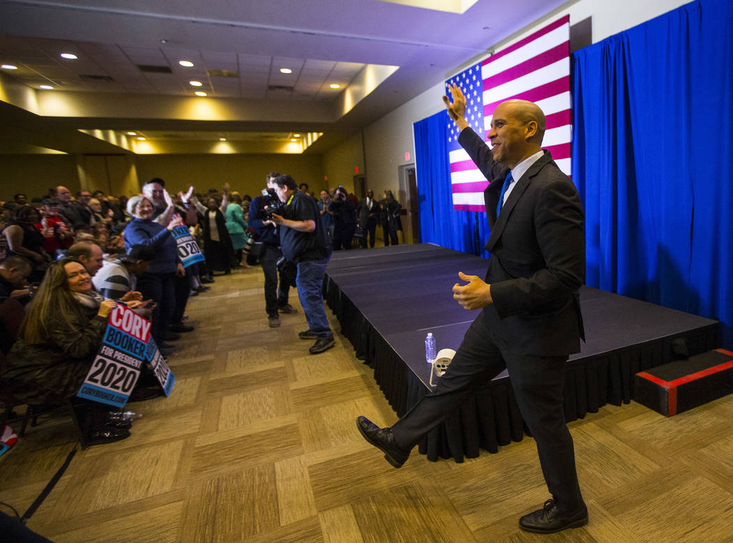 U.S. Sen. Cory Booker, D-N.J., a Democratic presidential hopeful, greets the crowd during a campaign rally at the Nevada Partners Event Center in North Las Vegas on Sunday, Feb. 24, 2019. (Chase S ...