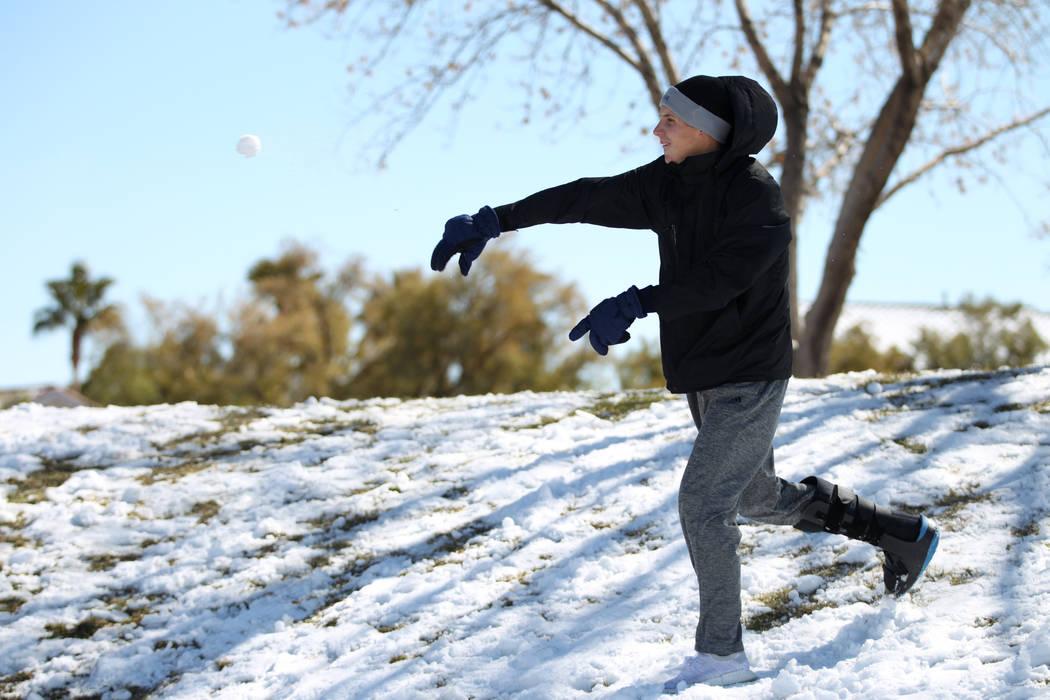 Drew Warnick, 17, of Las Vegas, plays in the snow with his siblings at Willows Park in Las Vegas, Friday, Feb. 22, 2019. (Erik Verduzco/Las Vegas Review-Journal) @Erik_Verduzco