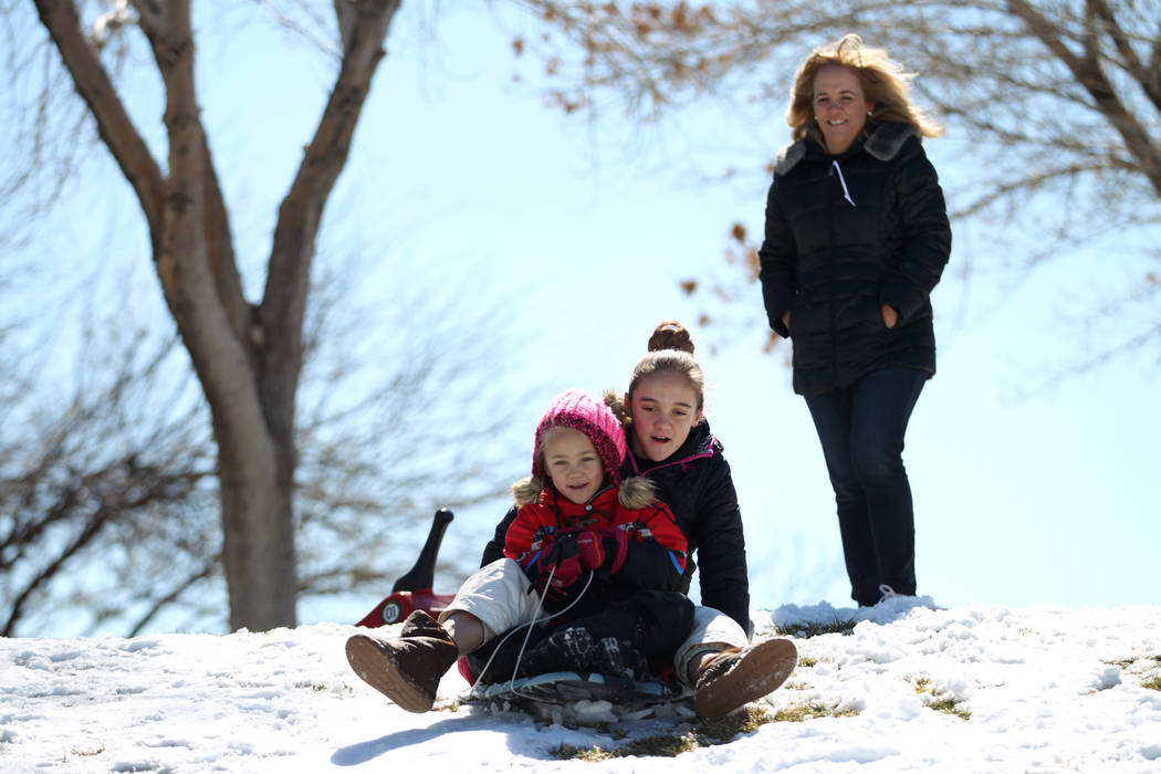 Abby Warnick, 6, with her sister Lydia, 12, play in the snow as their mother, Jennifer, watches at Willows Park in Las Vegas, Friday, Feb. 22, 2019. (Erik Verduzco/Las Vegas Review-Journal) @Erik_ ...