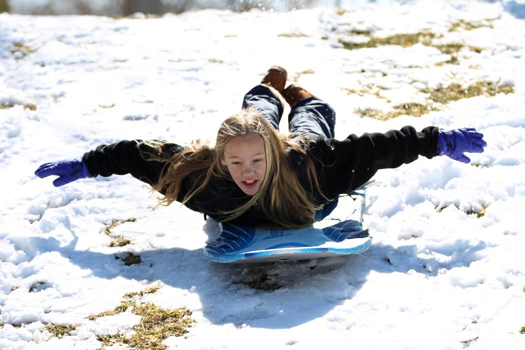 Lucy Warnick, 12, of Las Vegas, plays in the snow at Willows Park in Las Vegas, Friday, Feb. 22, 2019. (Erik Verduzco/Las Vegas Review-Journal) @Erik_Verduzco