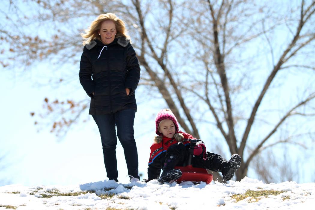 Abby Warnick, 6, plays in the snow as her mother, Jennifer, watches at Willows Park in Las Vegas, Friday, Feb. 22, 2019. (Erik Verduzco/Las Vegas Review-Journal) @Erik_Verduzco