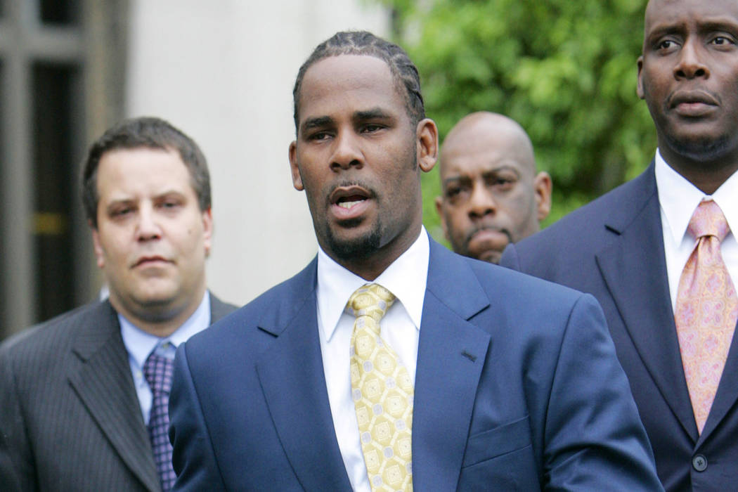 This June 13, 2008 file photo shows R&B singer R. Kelly leaving the Cook County Criminal Court Building in Chicago after a jury found him not guilty on all counts in his child pornography trial. ( ...