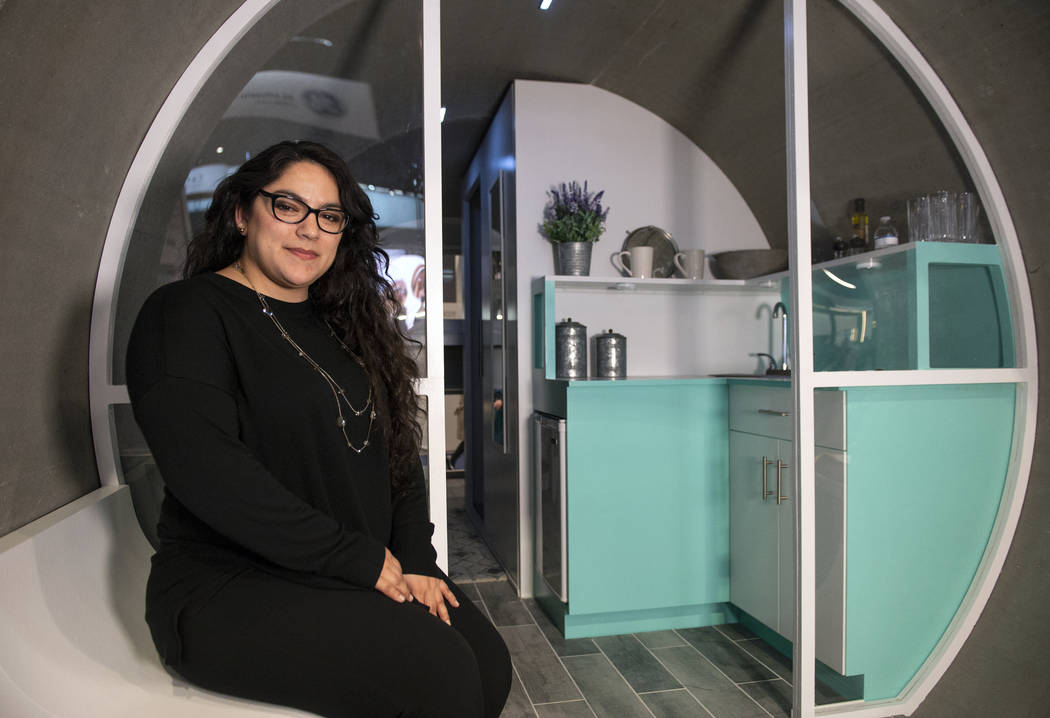 Sandra Guillen poses for a photograph outside of the home created as a part of the Rinker Materials Pipe Dream project at the Las Vegas Convention Center in Las Vegas, Wednesday, Feb. 20, 2019. (C ...