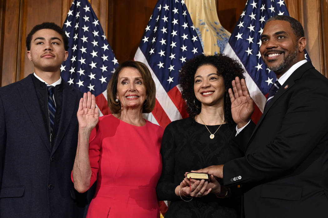 House Speaker Nancy Pelosi of Calif., second from left, poses during a ceremonial swearing-in with Rep. Steven Horsford, D-Nev., right, on Capitol Hill in Washington, Thursday, Jan. 3, 2019, durin ...
