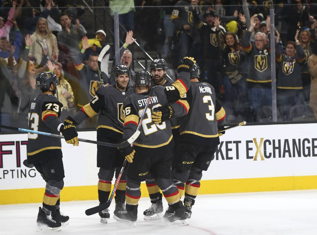 Golden Knights defenseman Shea Theodore, second from left, celebrates his goal with teammates during the second period of an NHL hockey game against the Winnipeg Jets at T-Mobile Arena in Las Vega ...