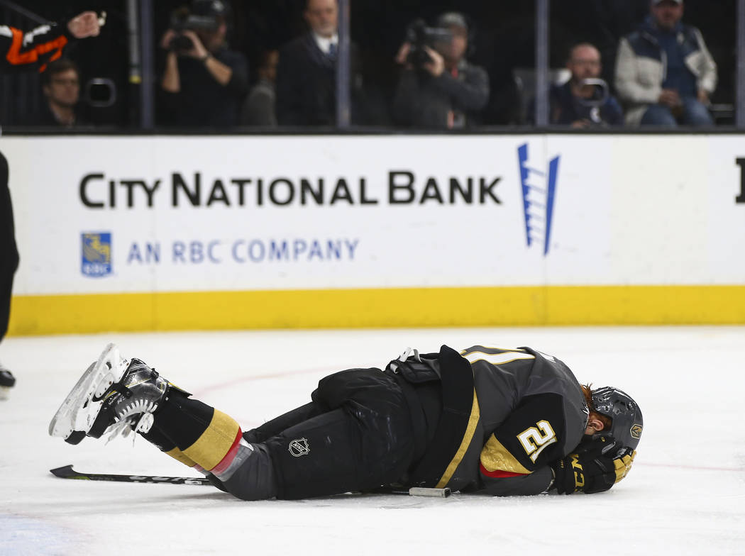 Golden Knights center Cody Eakin (21) on the ice after taking a hard hit during the second period of an NHL hockey game at T-Mobile Arena in Las Vegas on Friday, Feb. 22, 2019. (Chase Stevens/Las ...