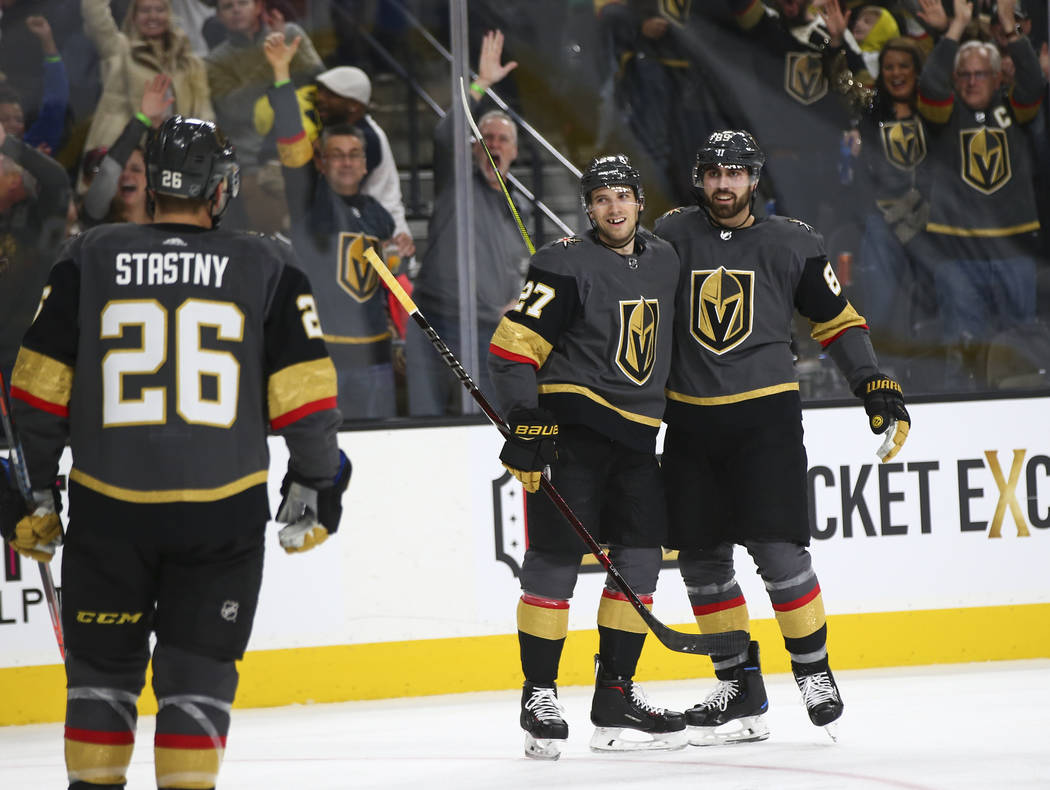 Golden Knights defenseman Shea Theodore (27) celebrates his goal with right wing Alex Tuch during the second period of an NHL hockey game against the Winnipeg Jets at T-Mobile Arena in Las Vegas o ...