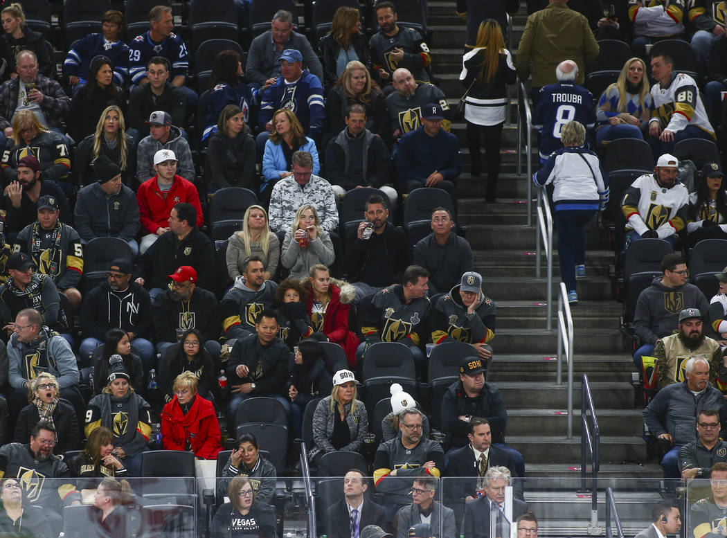 Golden Knights fans react in the final moments of the third period of an NHL hockey game against the Winnipeg Jets at T-Mobile Arena in Las Vegas on Friday, Feb. 22, 2019. (Chase Stevens/Las Vegas ...