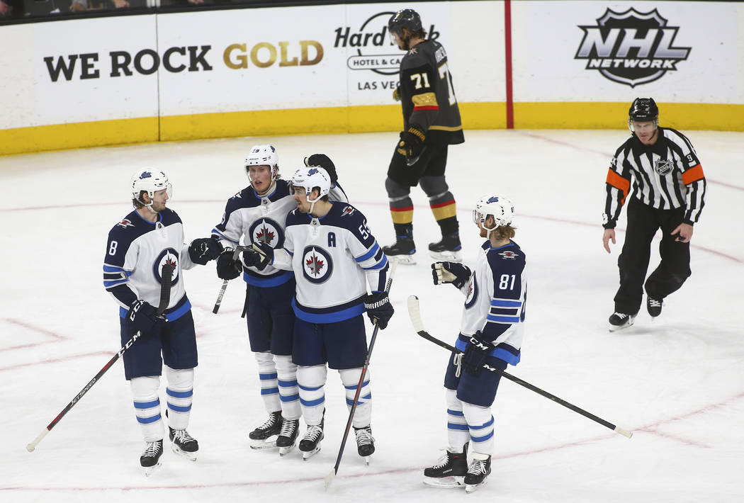 Winnipeg Jets players celebrate a goal against the Golden Knights during the third period of an NHL hockey game at T-Mobile Arena in Las Vegas on Friday, Feb. 22, 2019. (Chase Stevens/Las Vegas Re ...