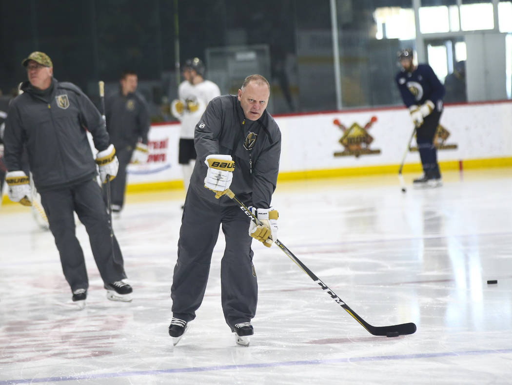 Golden Knights head coach Gerard Gallant moves the puck during practice at City National Arena in Las Vegas on Thursday, Feb. 21, 2019. (Chase Stevens/Las Vegas Review-Journal) @csstevensphoto