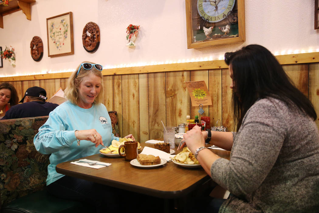 Ranae Roquet, left, and her friend Stacy Heath, visiting from Iowa, eat at the Omelet House in Las Vegas, Friday, Feb. 1, 2019. (Erik Verduzco/Las Vegas Review-Journal) @Erik_Verduzco