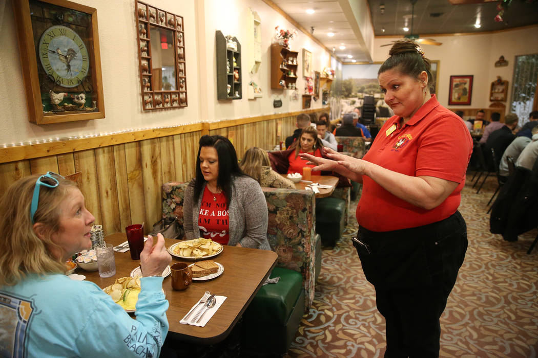Server Joanne Lopez, right, speaks with customers Ranae Roquet, far left, and her friend Stacy Heath, visiting from Iowa, at the Omelet House in Las Vegas, Friday, Feb. 1, 2019. (Erik Verduzco/Las ...