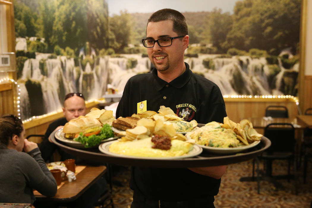 Assistant manager Nicholas Cosgrove runs food for customers at the Omelet House in Las Vegas, Friday, Feb. 1, 2019. (Erik Verduzco/Las Vegas Review-Journal) @Erik_Verduzco