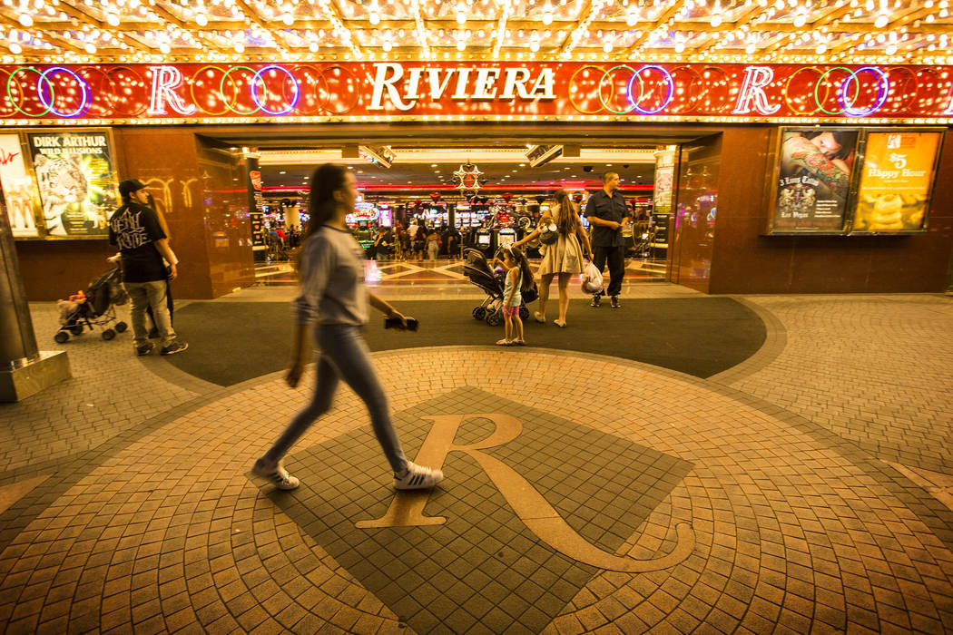 People walk in front of the Riviera hotel-casino in Las Vegas on Monday, April 20,2015. (Las Vegas Review-Journal)