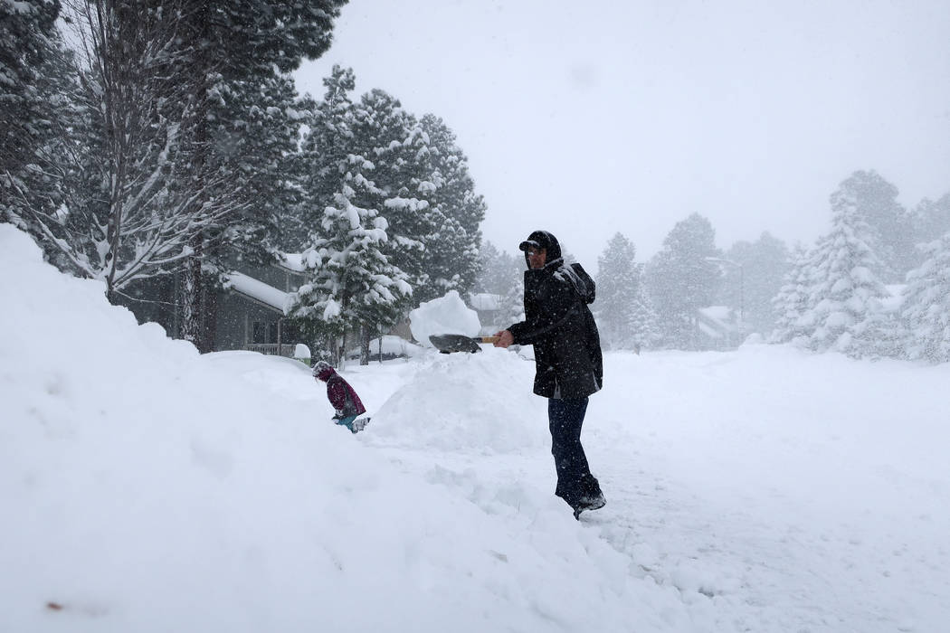 Morgan Baggs shovels the driveway at his home in Flagstaff, Arizona, on Thursday, Feb. 21, 2019. Schools across northern Arizona canceled classes and some government offices decided to close amid ...