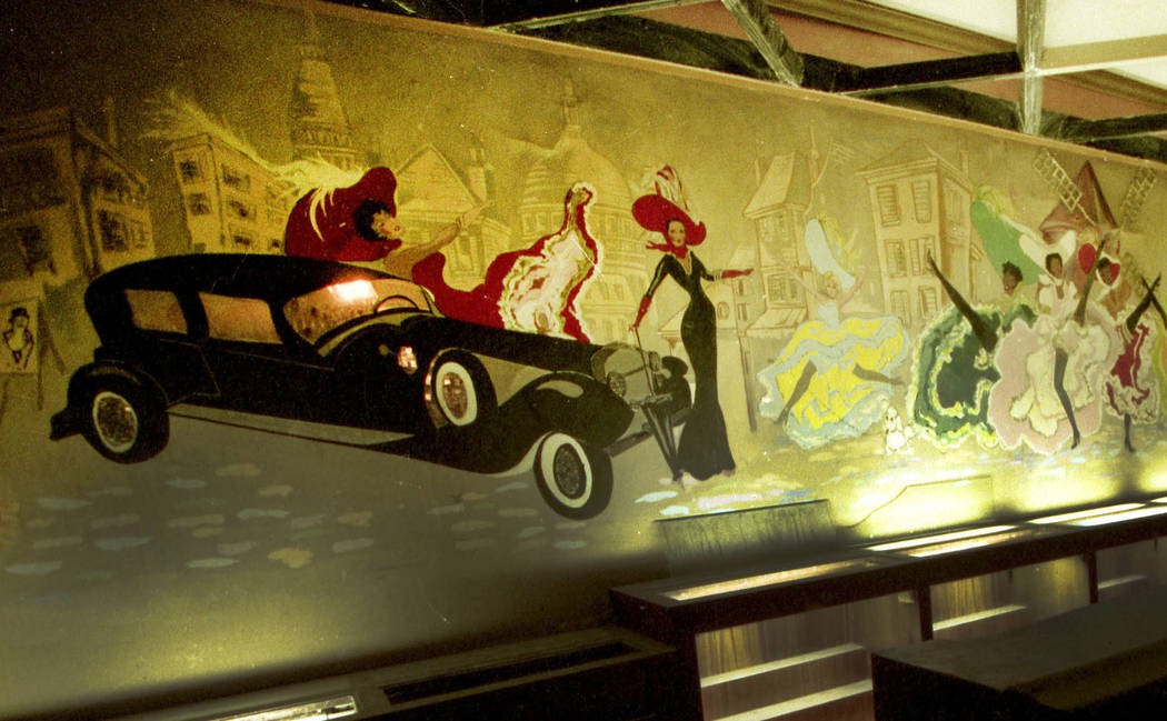 This 1999 file photo shows a mural of dancing showgirls, cars, buildings and drinks in the Club Rouge that was painted in 1955 when the Moulin Rouge opened. (Las Vegas Review-Journal, File)