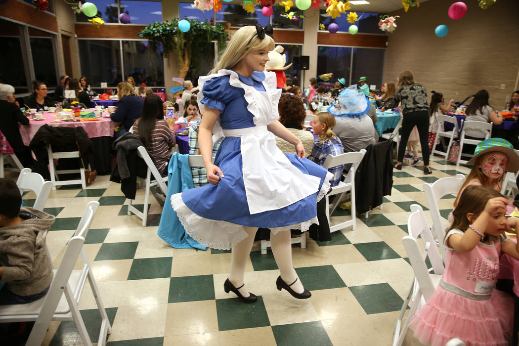 Brittney Reyes, in costume as Alice, entertains guests during the annual Mad Hatter Tea Party for children and families at the Summerlin Council in Las Vegas, Friday, Feb. 22, 2019. (Erik Verduzco ...