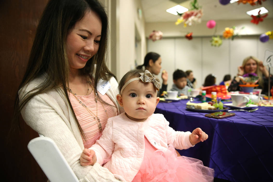 Desiree Roth and her 9-moth-old daughter Charlotte, of Las Vegas, attend the annual Mad Hatter Tea Party for children and families at the Summerlin Council in Las Vegas, Friday, Feb. 22, 2019. (Er ...
