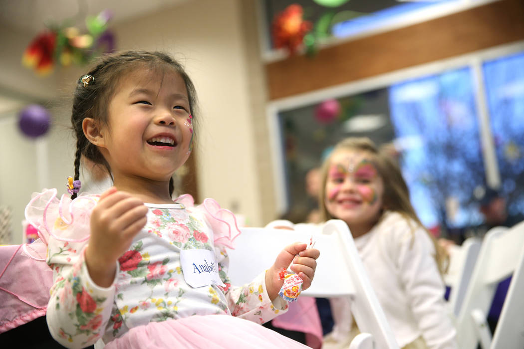 Anabelle Tsai, 5, of Las Vegas, laughs during the annual Mad Hatter Tea Party for children and families at the Summerlin Council in Las Vegas, Friday, Feb. 22, 2019. (Erik Verduzco/Las Vegas Revie ...