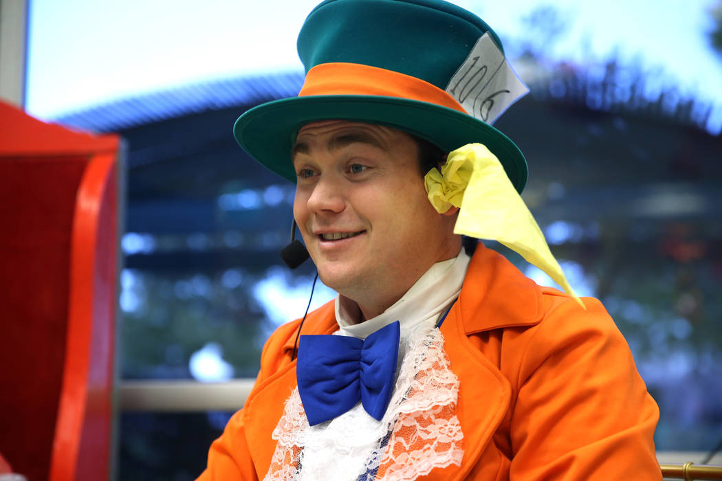 Dustin Winter, in costume as the Mad Hatter, entertains guests during the annual Mad Hatter Tea Party for children and families at the Summerlin Council in Las Vegas, Friday, Feb. 22, 2019. (Erik ...