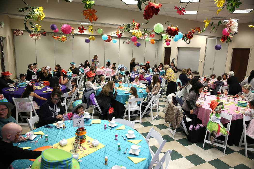 People attend the annual Mad Hatter Tea Party for children and families at the Summerlin Council in Las Vegas, Friday, Feb. 22, 2019. (Erik Verduzco/Las Vegas Review-Journal) @Erik_Verduzco