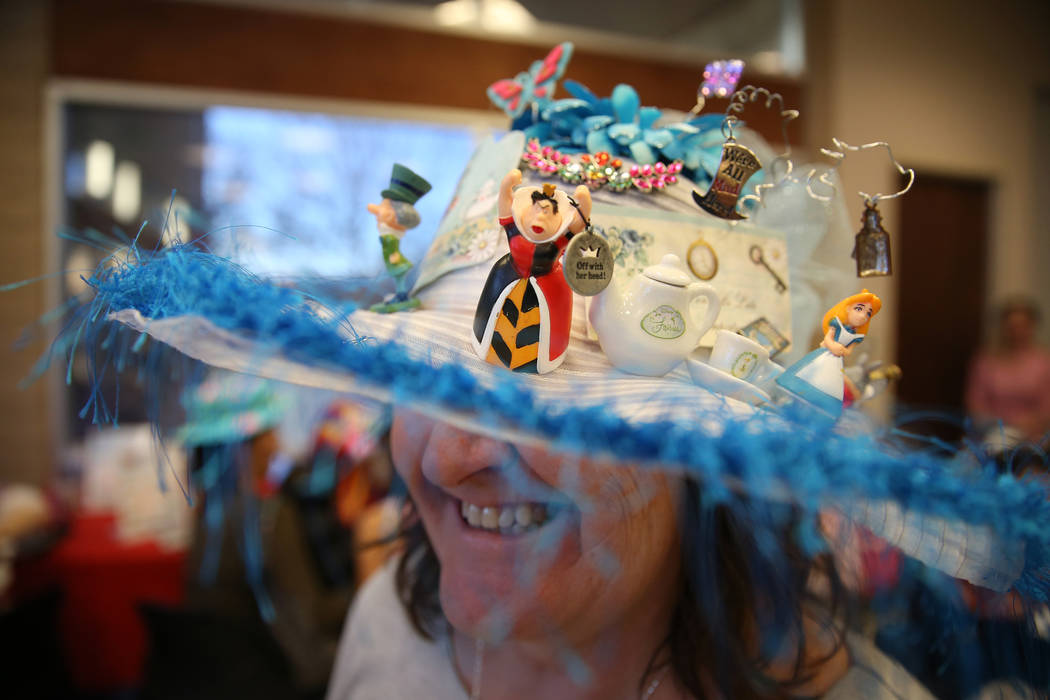 Debbie VanNatta wears a hat she made during the annual Mad Hatter Tea Party for children and families at the Summerlin Council in Las Vegas, Friday, Feb. 22, 2019. (Erik Verduzco/Las Vegas Review- ...