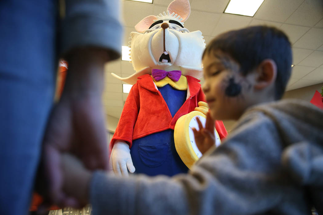The White Rabbit entertains guests of the annual Mad Hatter Tea Party for children and families at the Summerlin Council in Las Vegas, Friday, Feb. 22, 2019. (Erik Verduzco/Las Vegas Review-Journa ...
