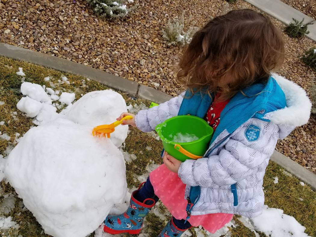 Frankie Cecere, 3, crafted and then toppled her first snowman on Feb. 21 in an Inspirada neighborhood park on the southern edge of Henderson development. The family repurposed its beach toys for s ...