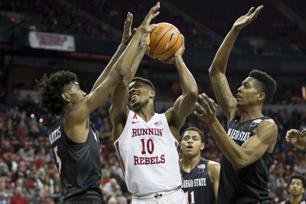 UNLV Rebels forward Shakur Juiston (10) goes up for a shot against San Diego State Aztecs forward Jalen McDaniels (5) and forward Malik Pope (21) at the Thomas & Mack Center in Las Vegas, Satu ...