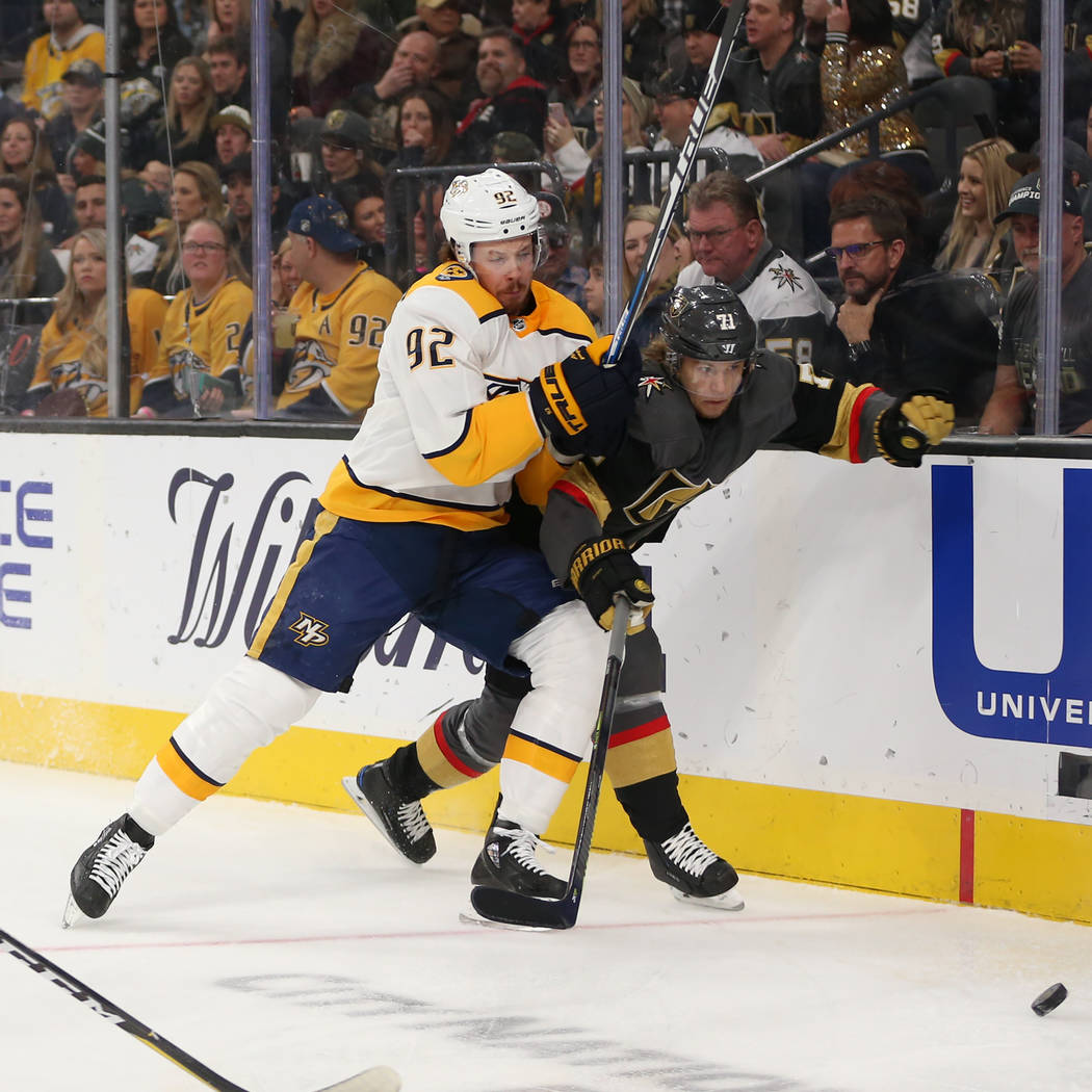 Nashville Predators center Ryan Johansen (92) defends against Vegas Golden Knights center William Karlsson (71) during the first period of an NHL hockey game at T-Mobile Arena in Las Vegas, Saturd ...