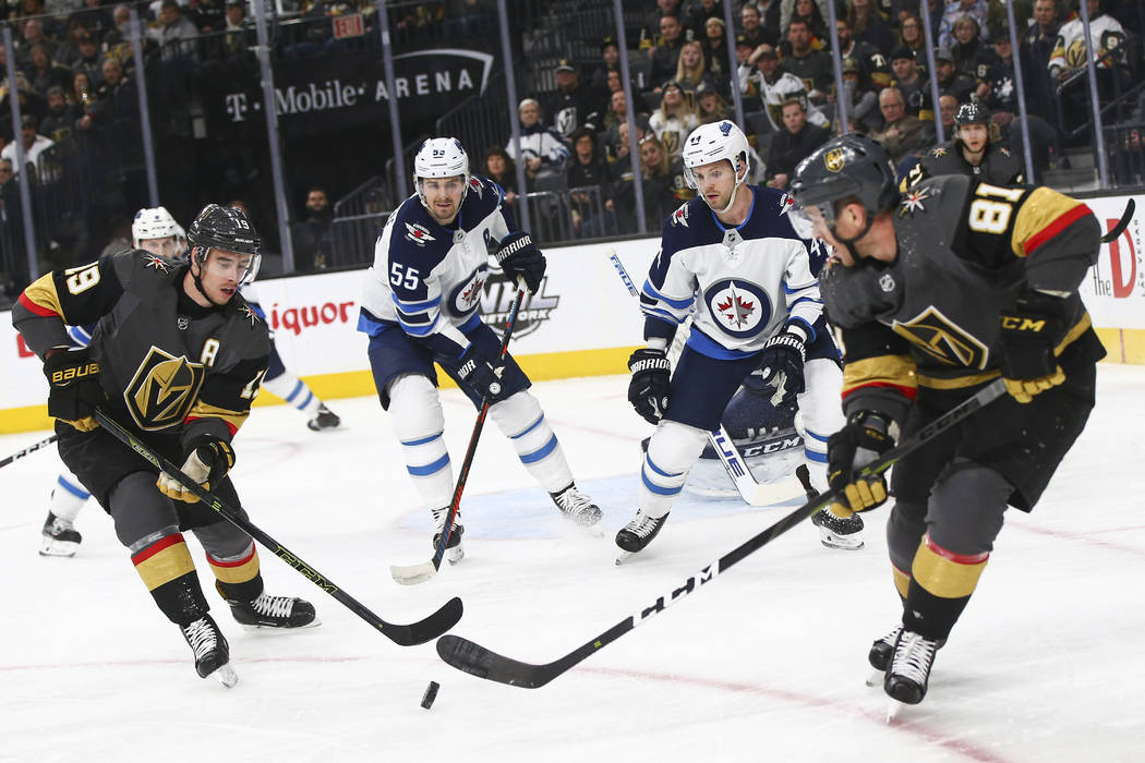 Golden Knights right wing Reilly Smith (19) and center Jonathan  Marchessault (81) e011acbf3544