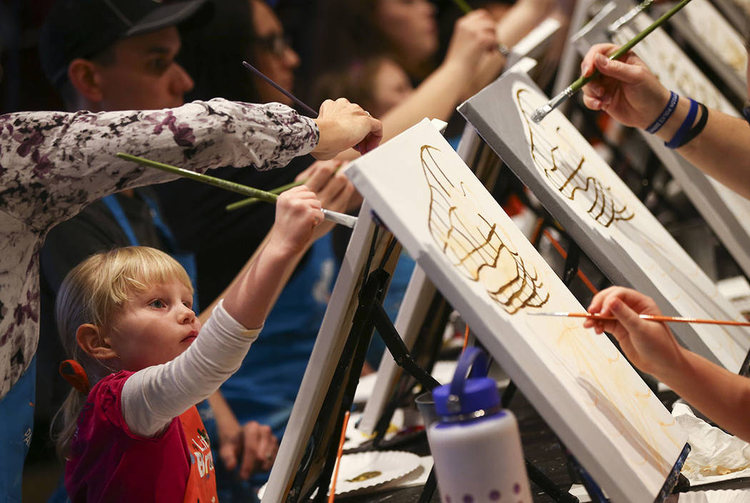 Aubree Clark, 5, paints during a painting session featuring a portrait of Golden Knights mascot Chance at Pinot's Palette at The District in Henderson on Sunday, Feb. 24, 2019. The event was held ...