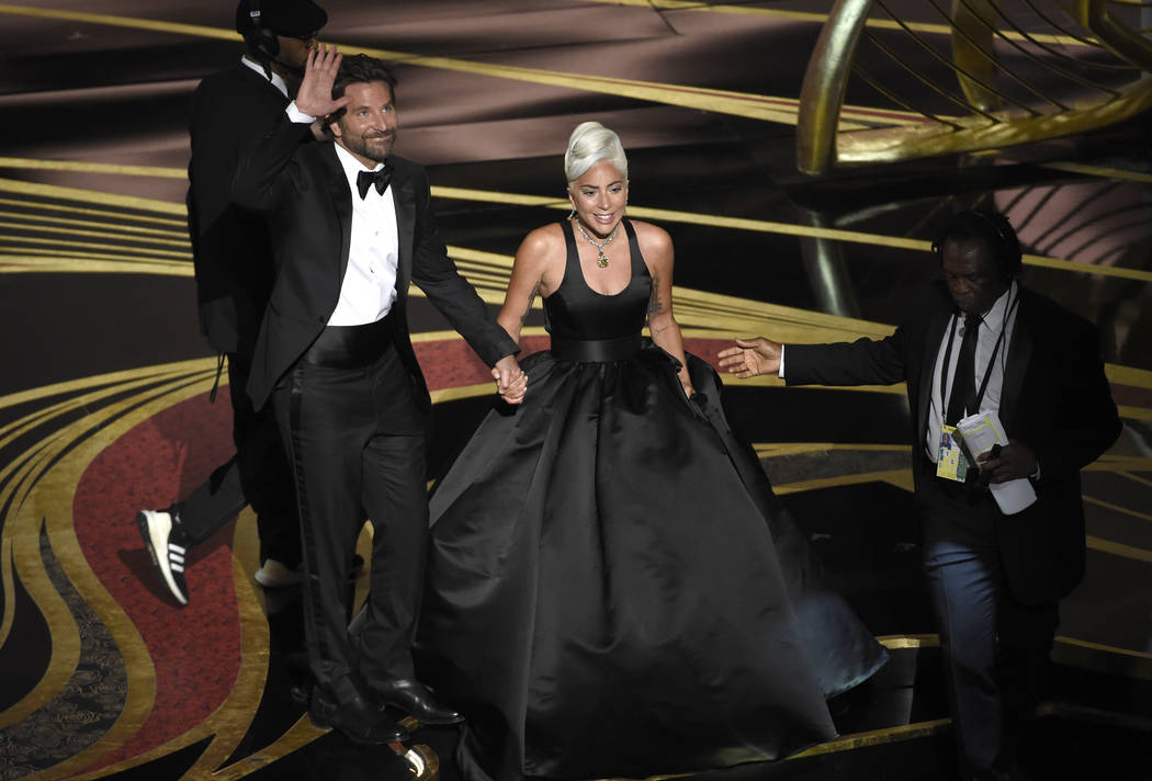 "Bradley Cooper, left, and Lady Gaga react to the audience after a performance of ""Shallow"" from ""A Star is Born"" at the Oscars on Sunday, Feb. 24, 2019, at the Dolby Theatre in ..."