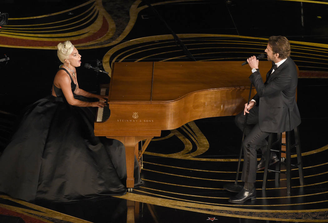 "Lady Gaga, left, and Bradley Cooper perform ""Shallow"" from ""A Star is Born"" at the Oscars on Sunday, Feb. 24, 2019, at the Dolby Theatre in Los Angeles. (Photo by Chris Pizzell ..."