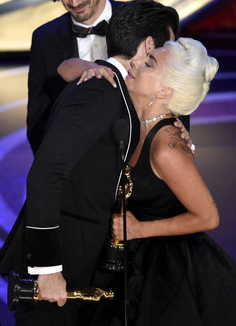 "Lady Gaga, right, and Mark Ronson hug after accepting the award for best original song for ""Shallow"" from ""A Star Is Born"" at the Oscars on Sunday, Feb. 24, 2019, at the Dolby ..."