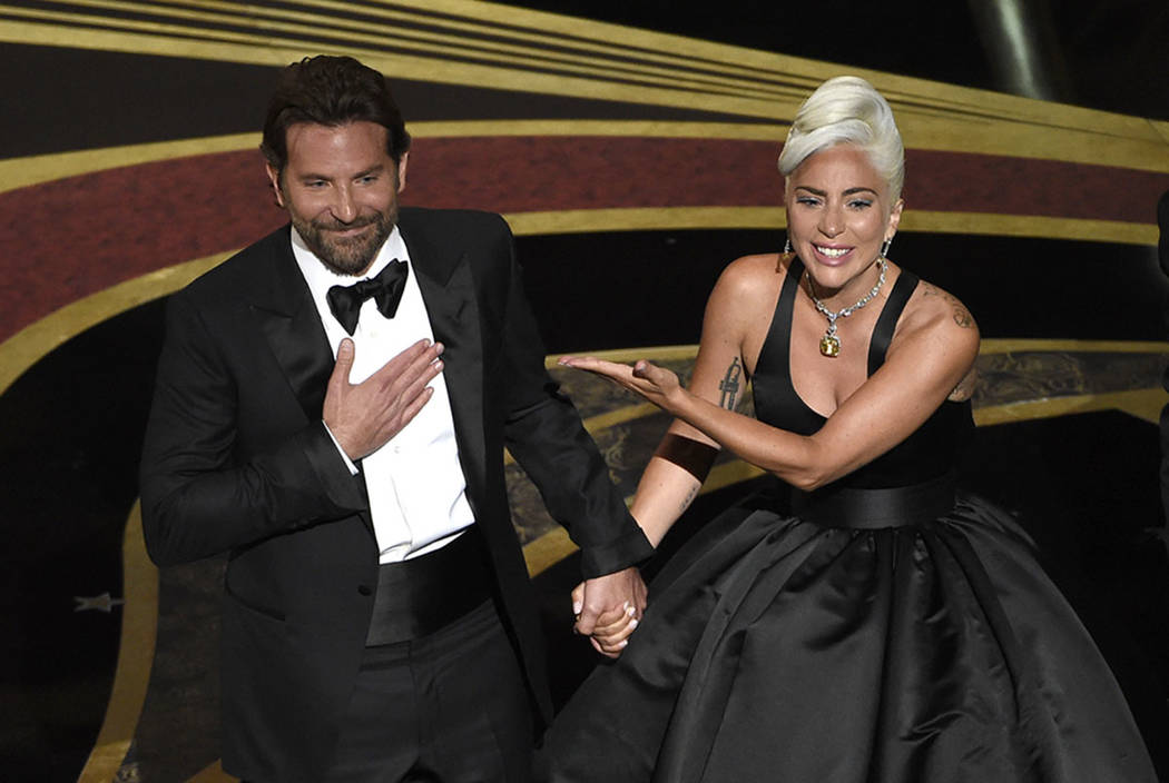 "Bradley Cooper, left, and Lady Gaga react to the audience after a performance of ""Shallow"" from 'A Star is Born' at the Oscars on Sunday, Feb. 24, 2019, at the Dolby Theatre in Los Angel ..."