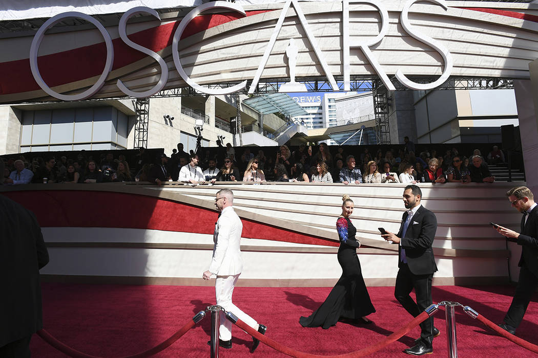 Media walk on the red carpet before the Oscars on Sunday, Feb. 24, 2019, at the Dolby Theatre in Los Angeles. (Photo by Jordan Strauss/Invision/AP)