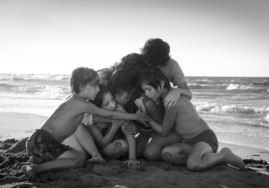"This image released by Netflix shows Yalitza Aparicio, center, in a scene from the film ""Roma,"" by filmmaker Alfonso Cuaron. The film is nominated for an Oscar for both best foreign lang ..."