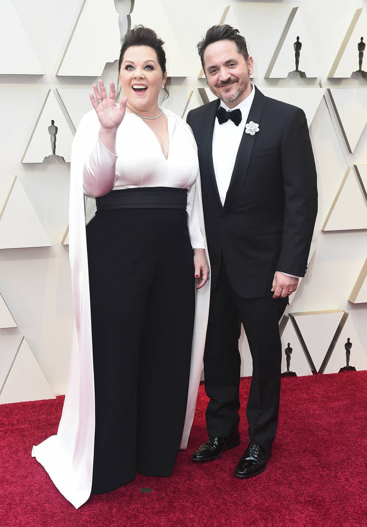 Melissa McCarthy, left, and Ben Falcone arrive at the Oscars on Sunday, Feb. 24, 2019, at the Dolby Theatre in Los Angeles. (Photo by Jordan Strauss/Invision/AP)