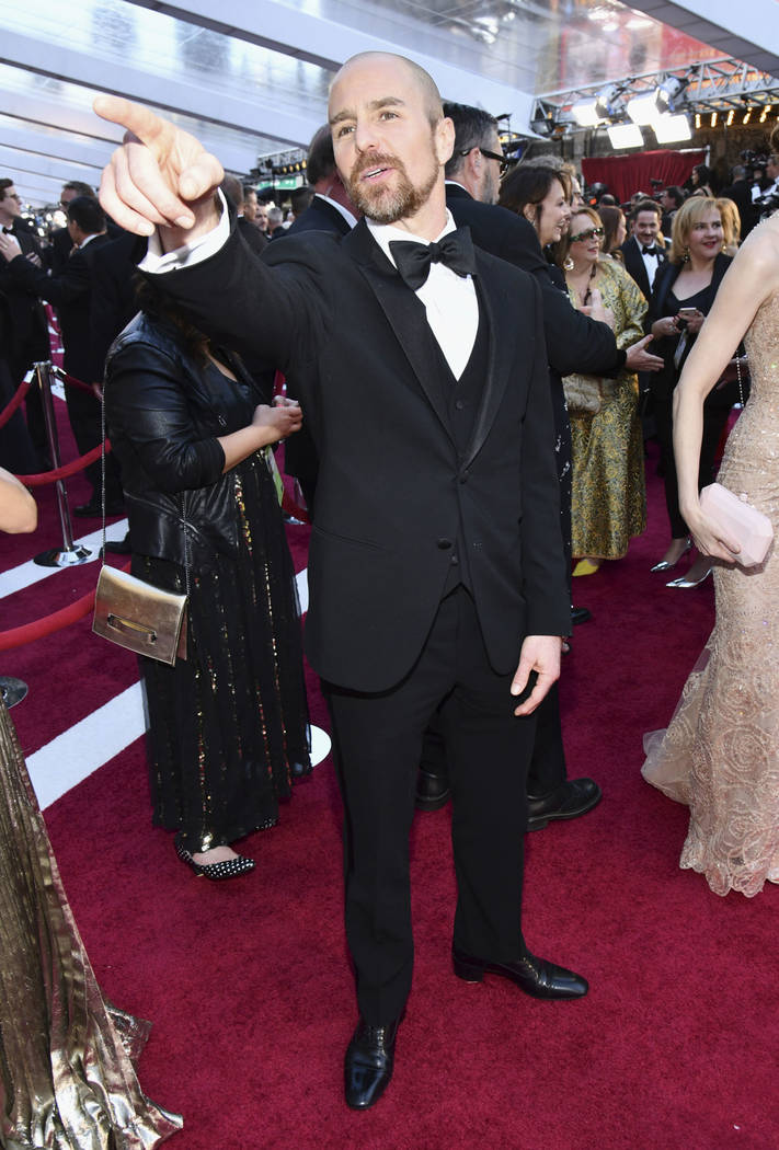 Sam Rockwell arrives at the Oscars on Sunday, Feb. 24, 2019, at the Dolby Theatre in Los Angeles. (Photo by Charles Sykes/Invision/AP)