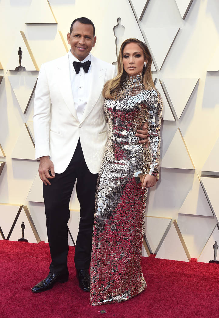 Alex Rodriguez, left, and Jennifer Lopez arrive at the Oscars on Sunday, Feb. 24, 2019, at the Dolby Theatre in Los Angeles. (Photo by Jordan Strauss/Invision/AP)