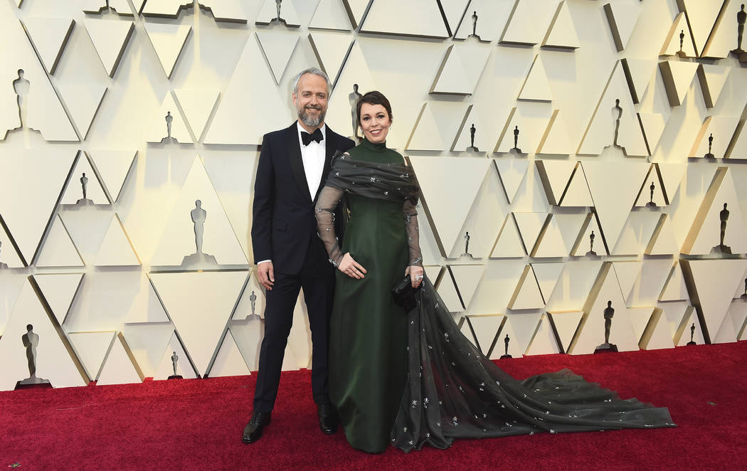 Ed Sinclair, left, and Olivia Colman arrive at the Oscars on Sunday, Feb. 24, 2019, at the Dolby Theatre in Los Angeles. (Photo by Jordan Strauss/Invision/AP)
