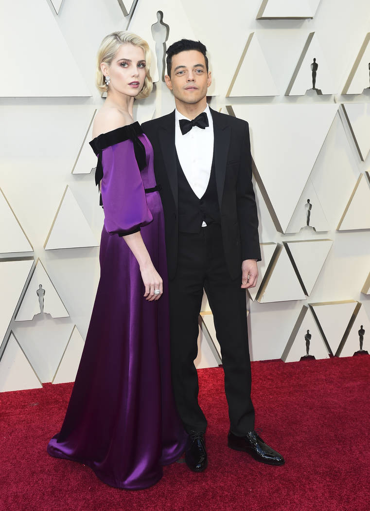 Lucy Boynton, left, and Rami Malek arrive at the Oscars on Sunday, Feb. 24, 2019, at the Dolby Theatre in Los Angeles. (Photo by Jordan Strauss/Invision/AP)