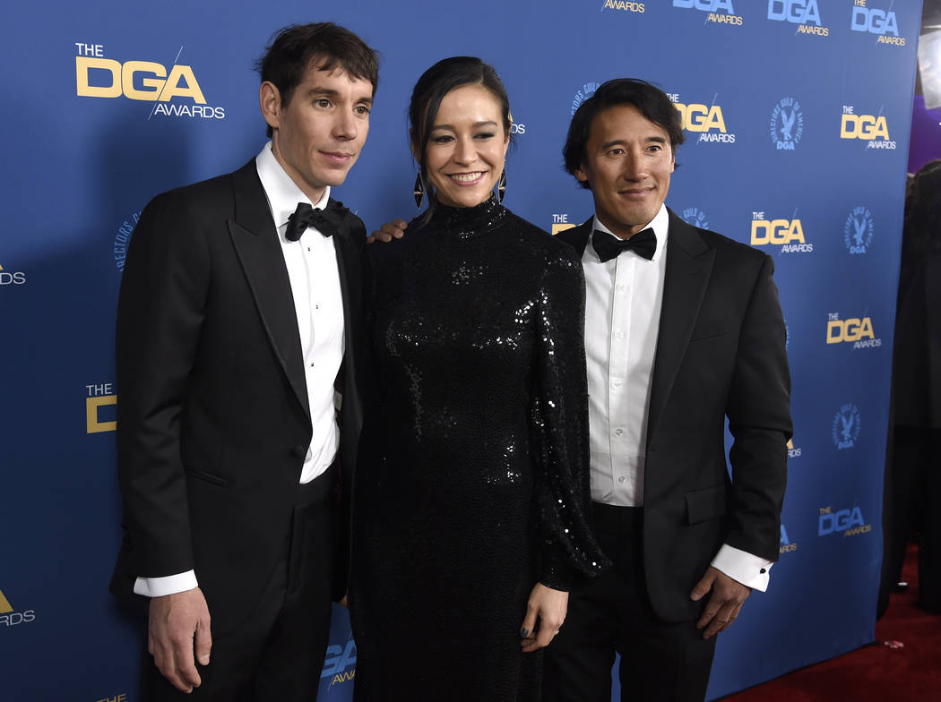 Alex Honnold, from left, Elizabeth Chai Vasarhelyi and Jimmy Chin arrive at the 71st annual DGA Awards at the Ray Dolby Ballroom on Saturday, Feb. 2, 2019, in Los Angeles. (Photo by Chris Pizzello ...