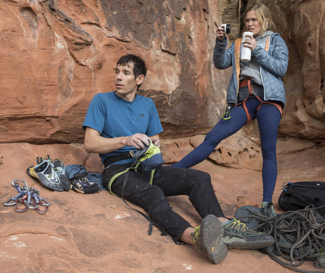 "Alex Honnold, left, and girlfriend Cassandra ""Sanni"" McCandless prepare to climb at The Gallery at Red Rock Canyon on Monday, Dec. 17, 2018, in Las Vegas. Honnold, arguably the best rock climb ..."
