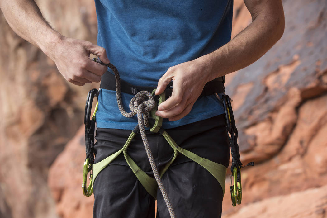 Alex Honnold prepares his gear to climb The Gallery at Red Rock Canyon on Monday, Dec. 17, 2018, in Las Vegas. Honnold, arguably the best rock climber in the world, solo climbed El Capitan, a 3,00 ...