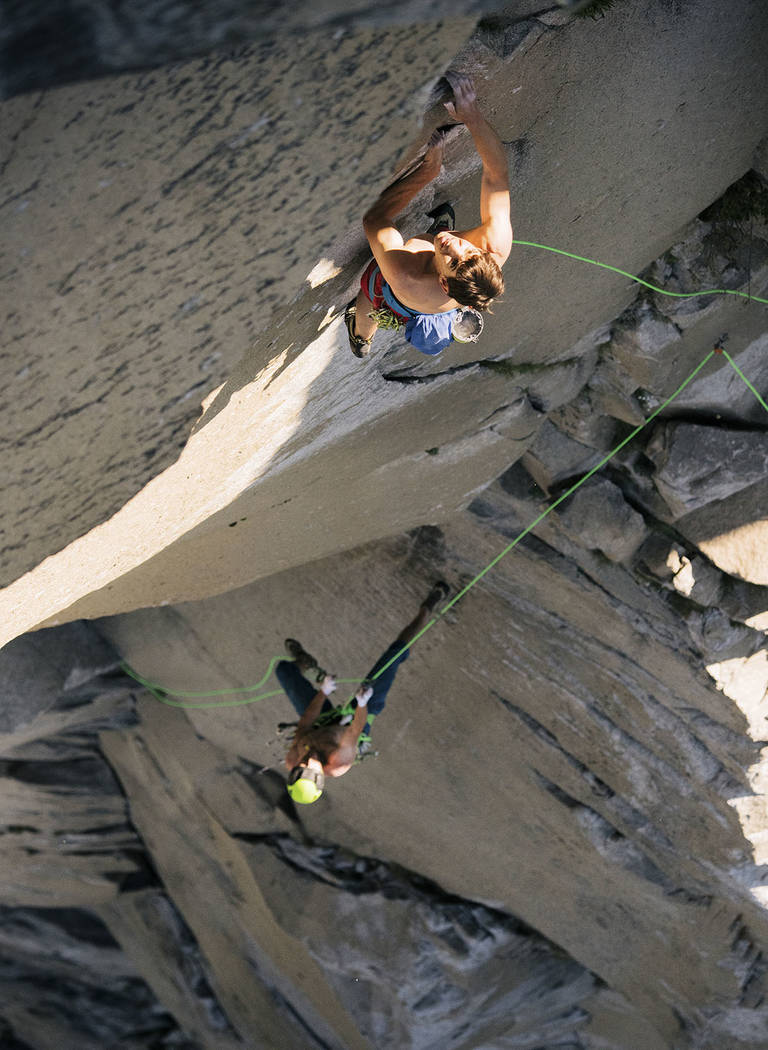 In this June 3, 2018 photo provided by Corey Rich, Alex Honnold, top and Tommy Caldwell climb The Nose of El Capitan in Yosemite National Park, Calif. Days after two of the world's most celebrated ...