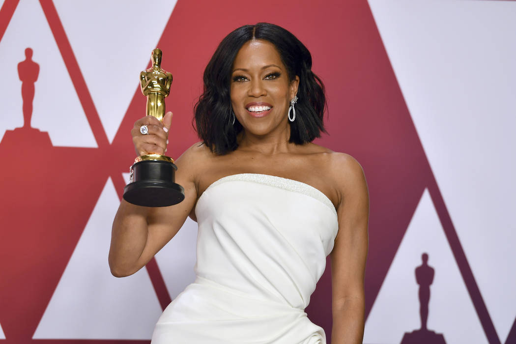 "Regina King poses with the award for best performance by an actress in a supporting role for ""If Beale Street Could Talk"" in the press room at the Oscars on Sunday, Feb. 24, 2019, at the ..."