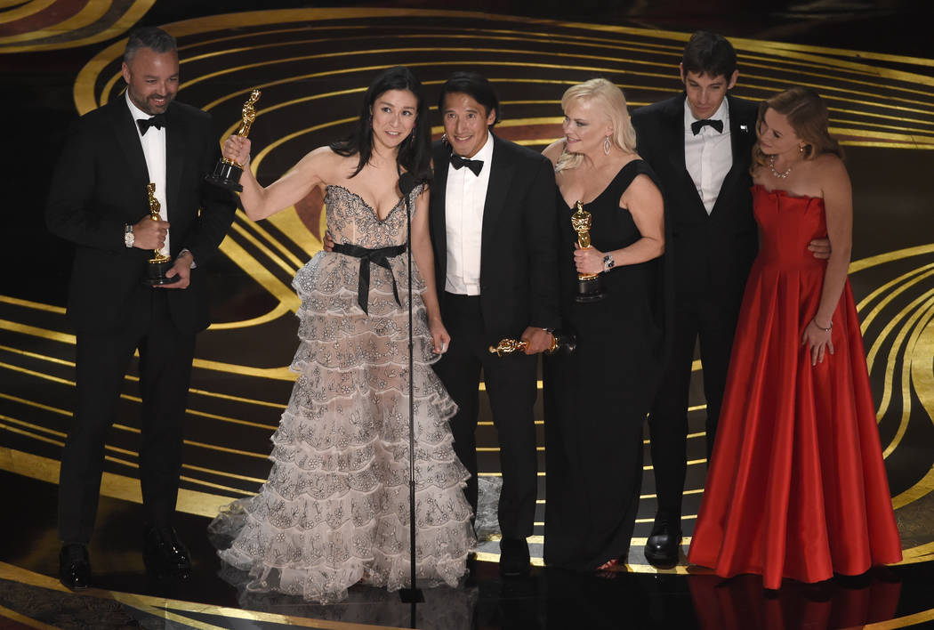 "Evan Hayes, from left, Elizabeth Chai Vasarhelyi, Jimmy Chin, Shannon Dill, Alex Honnold, and Sanni McCandless accept the award for best documentary feature for ""Free Solo"" at the Oscars ..."