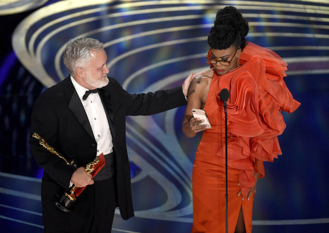 """Jay Hart, left, and Hannah Beachler accept the award for best production design for """"Black Panther"""" at the Oscars on Sunday, Feb. 24, 2019, at the Dolby Theatre in Los Angeles. (Photo by ..."""